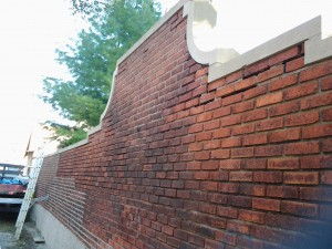 Beyond home additions we often take on historic masonry restoration. This wall has stood for over a century. Here it is halfway through the restoration.