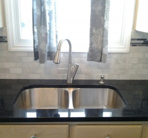 Another home addition we're proud of is this back splash, which also took a week to finish. First we removed old tile and drywall, and then replaced the drywall. The back splash itself we made with marble and glass. We finished with grouting and adding a water repellent finish to the marble and glass.